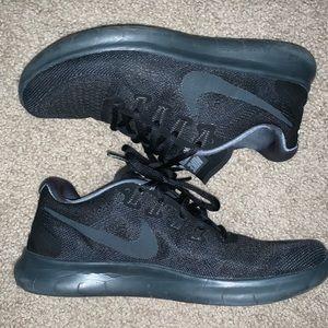 Black Nike free run shoes
